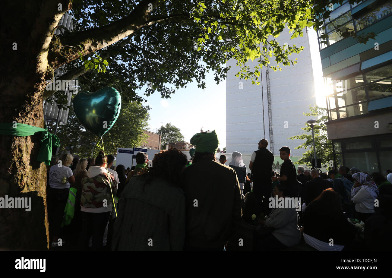 Family and friends of the 72 people who lost their lives in the Grenfell Tower block fire gather outside Grenfell Tower, London, for a wreath laying ceremony to mark the two-year anniversary. - Stock Image