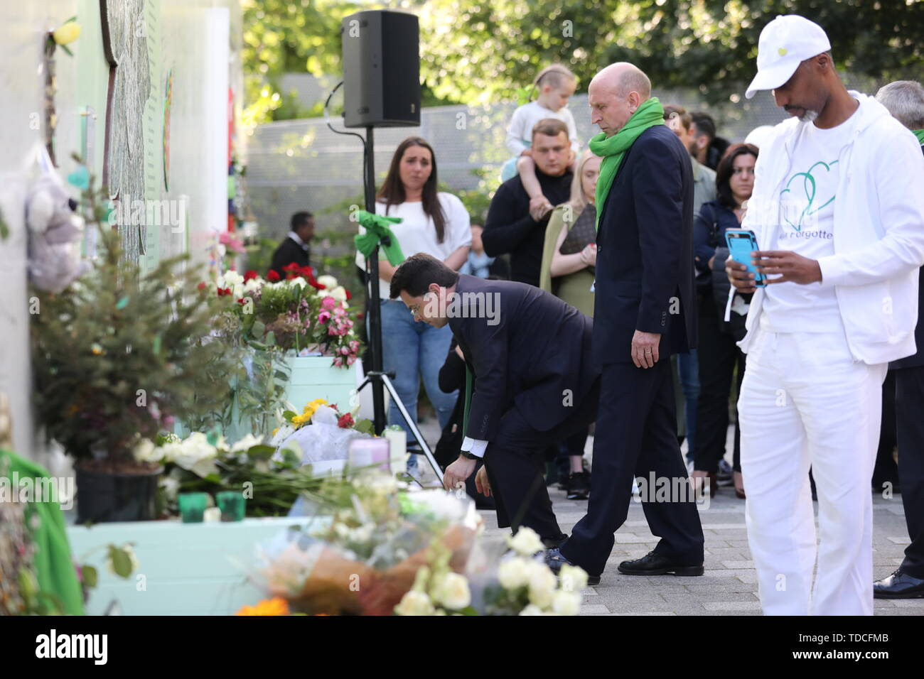 Shadow housing secretary John Healey (centre)during a wreath laying ceremony outside Grenfell Tower, London, to mark the two-year anniversary of the tower block fire in memory of the 72 people who lost their lives. - Stock Image