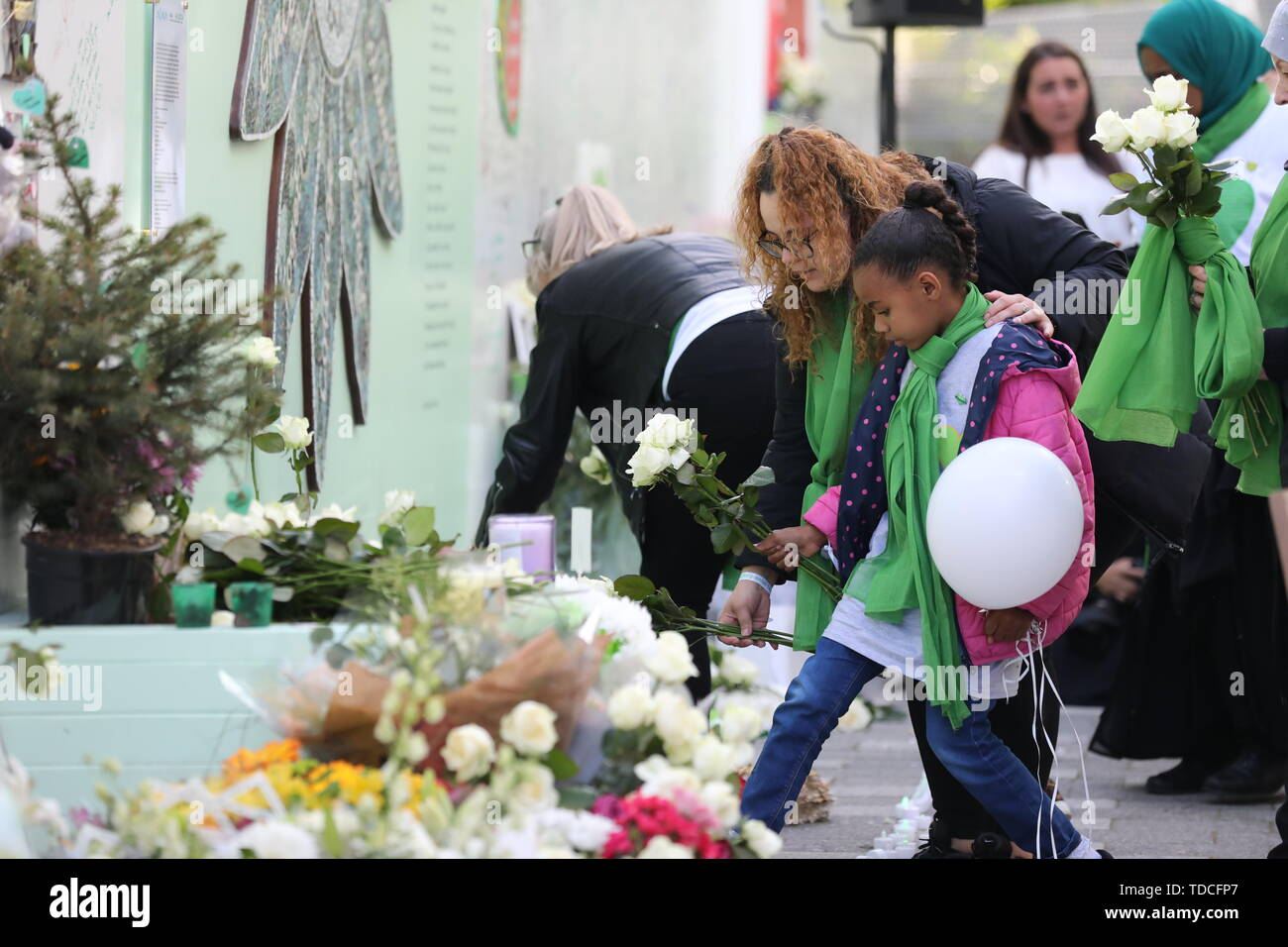 Family and friends of the 72 people who lost their lives in the Grenfell Tower block lay flowers during a wreath laying ceremony outside Grenfell Tower, London, to mark the two-year anniversary. - Stock Image
