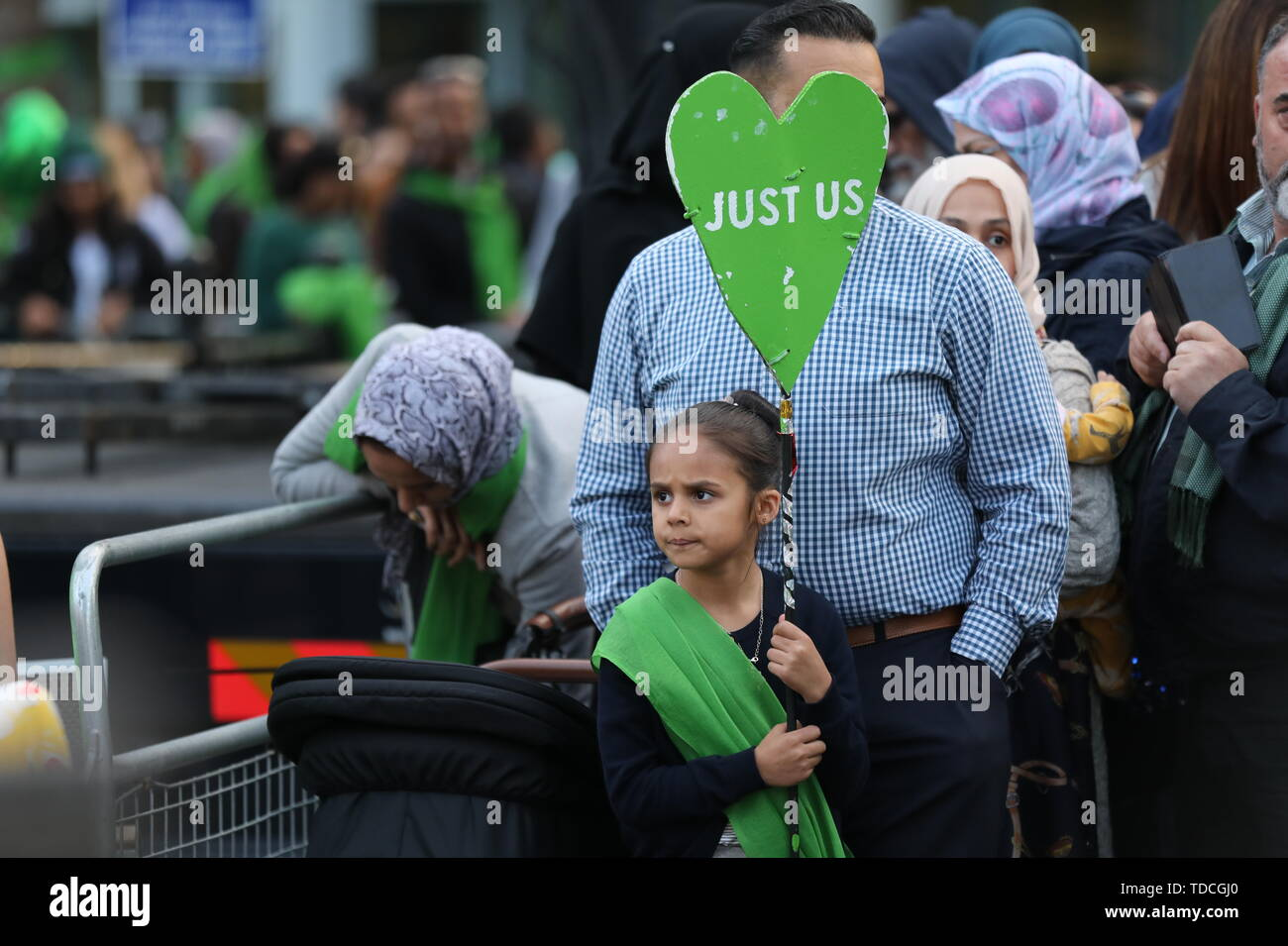 Family and friends of the 72 people who lost their lives in the Grenfell Tower block during a vigil outside Grenfell Tower, London, to mark the two-year anniversary. - Stock Image