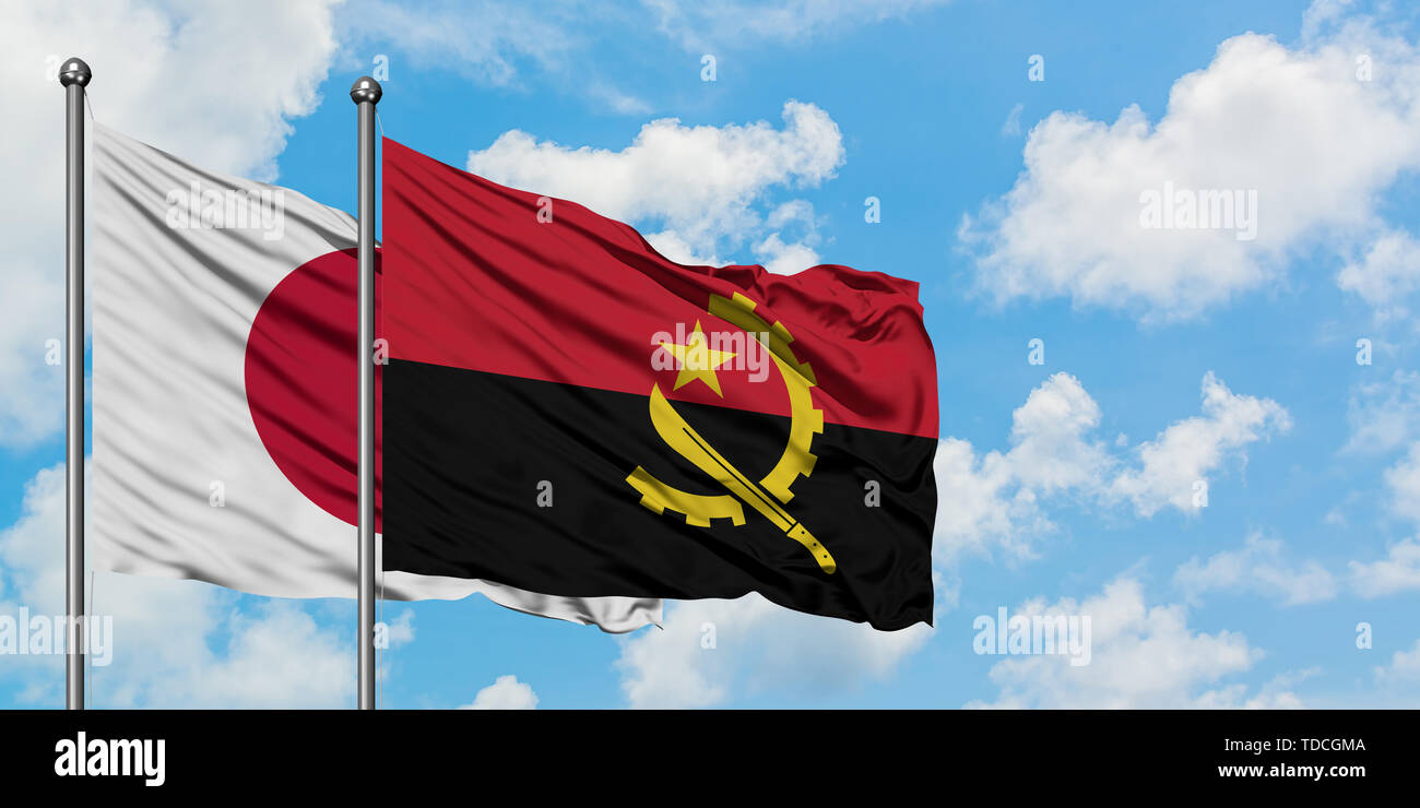 Japan and Angola flag waving in the wind against white cloudy blue sky together. Diplomacy concept, international relations. Stock Photo