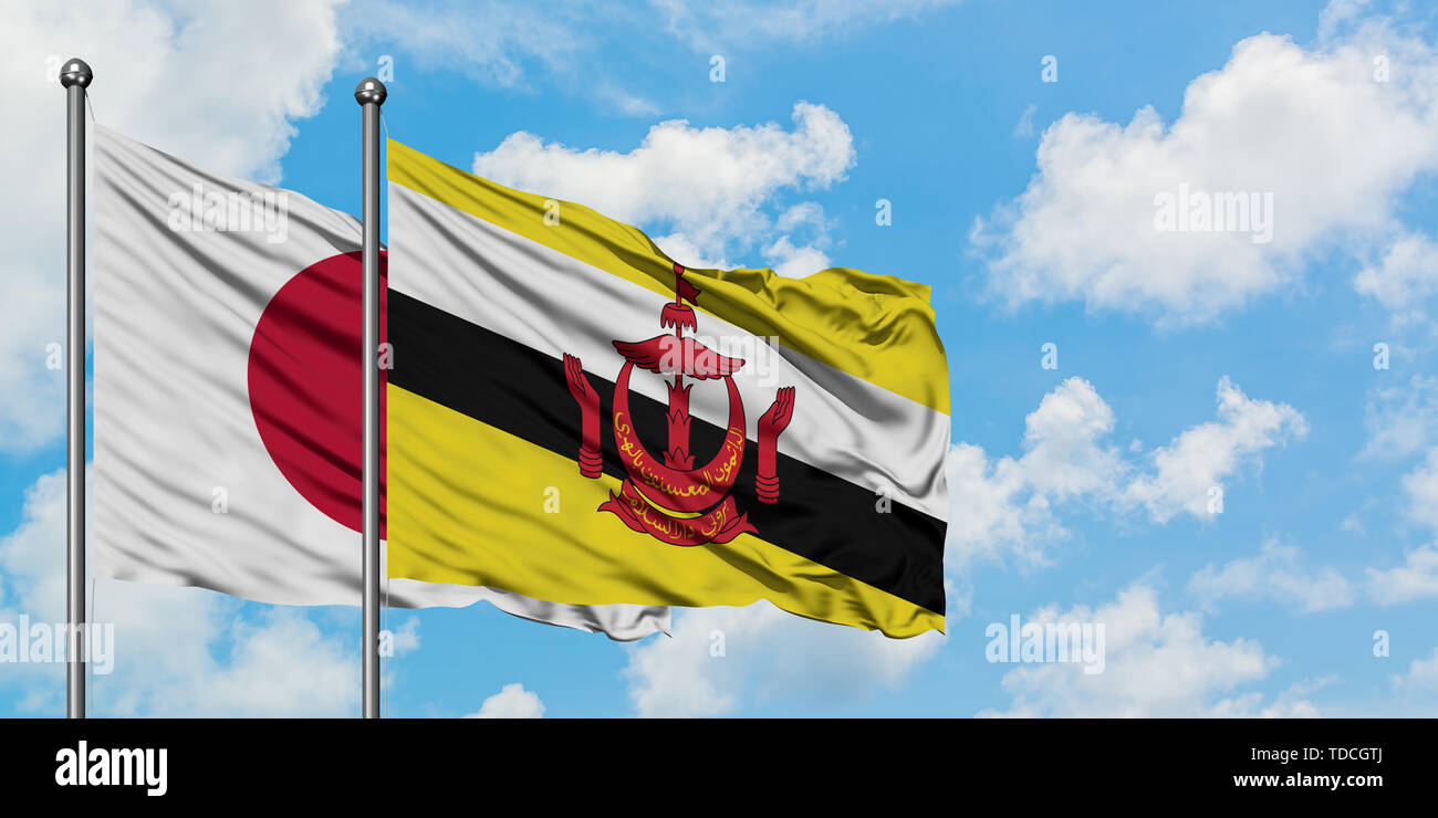 Japan and Brunei flag waving in the wind against white cloudy blue sky together. Diplomacy concept, international relations. - Stock Image