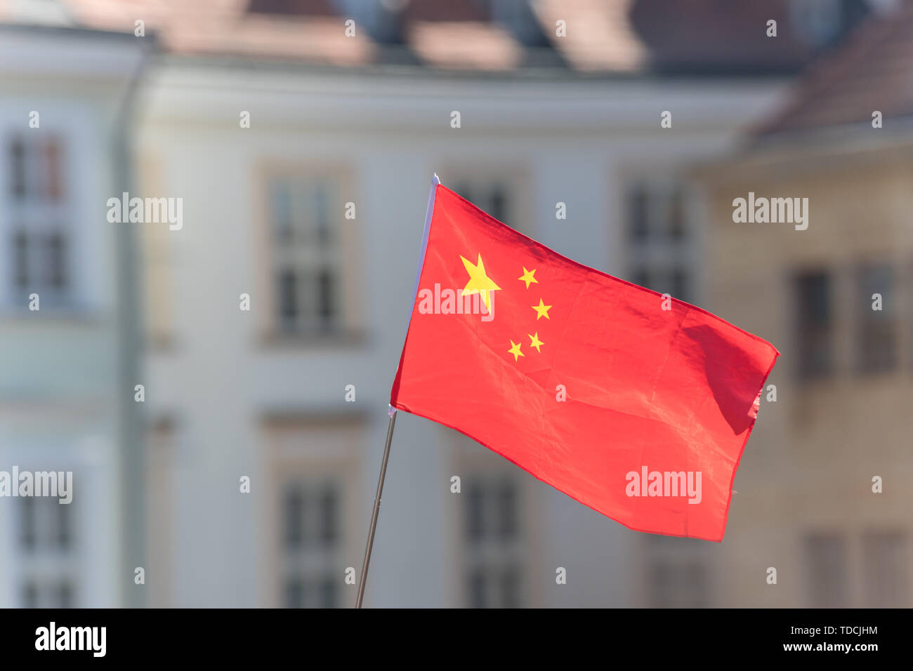 PRAGUE, CZECH REPUBLIC 16-04-2019: China flag waving in the wind against blurred historic building Stock Photo