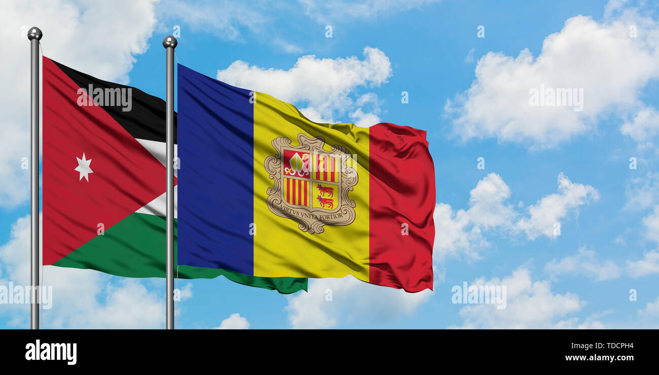 Jordan and Andorra flag waving in the wind against white cloudy blue sky together. Diplomacy concept, international relations. Stock Photo