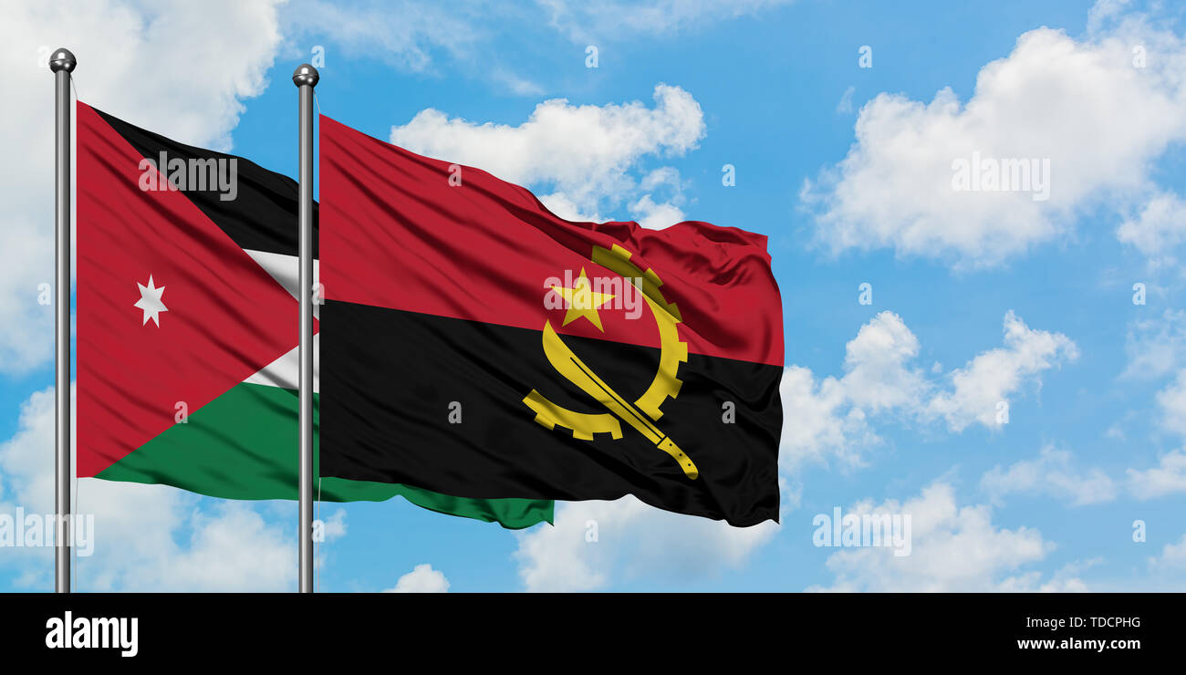 Jordan and Angola flag waving in the wind against white cloudy blue sky together. Diplomacy concept, international relations. - Stock Image