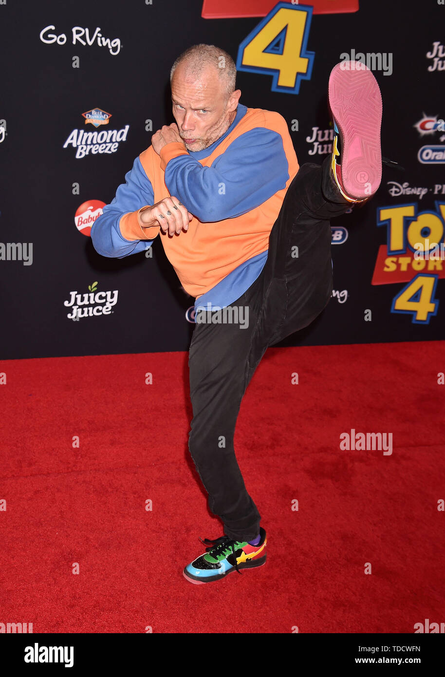 HOLLYWOOD, CA - JUNE 11: Flea arrives at the premiere of Disney and Pixar's 'Toy Story 4' at the El Capitan Theatre on June 11, 2019 in Los Angeles, California. - Stock Image