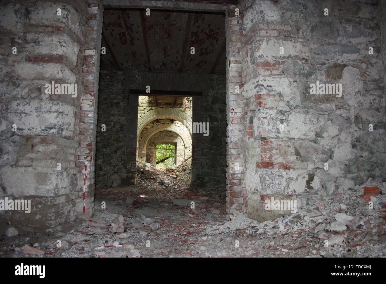 Fort Bastione, a nineteenth-century military fortress, abandoned to the neglect of nature. distressing stone construction inside and out. wild nature  - Stock Image