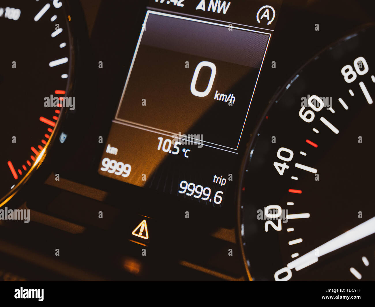 Stationary new modern car speedometer dashboard with 0 kmh current speed on the dot matrix display screen - Stock Image