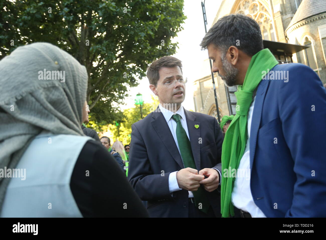 Secretary of State for Housing, Communities and Local Government James Brokenshire (left) during the wreath laying ceremony outside Grenfell Tower, London, to mark the two-year anniversary of the tower block fire. - Stock Image