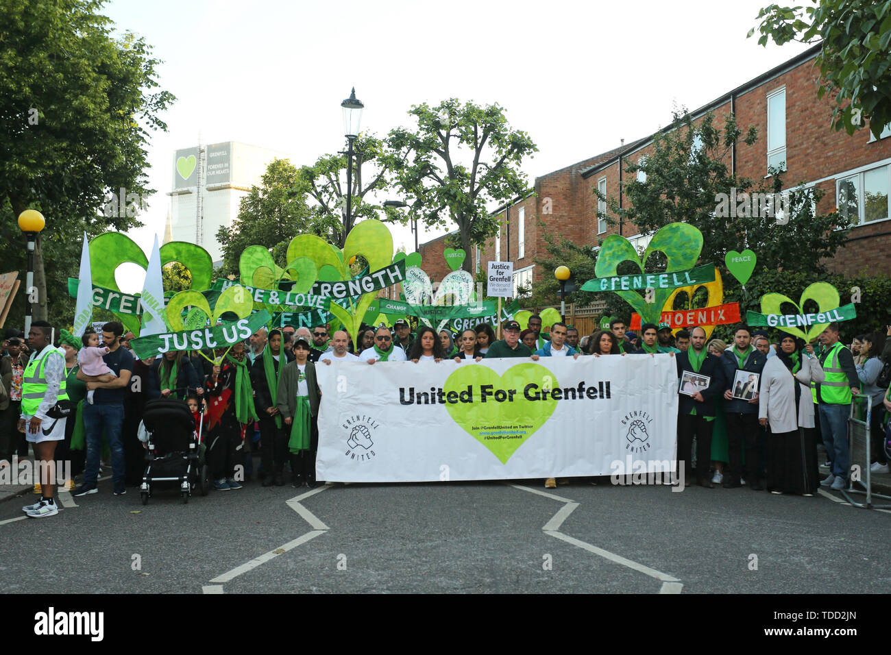 Family and friends of the 72 people who lost their lives in the Grenfell Tower block fire, outside Grenfell Tower, London, during a silent walk to mark the two-year anniversary. - Stock Image