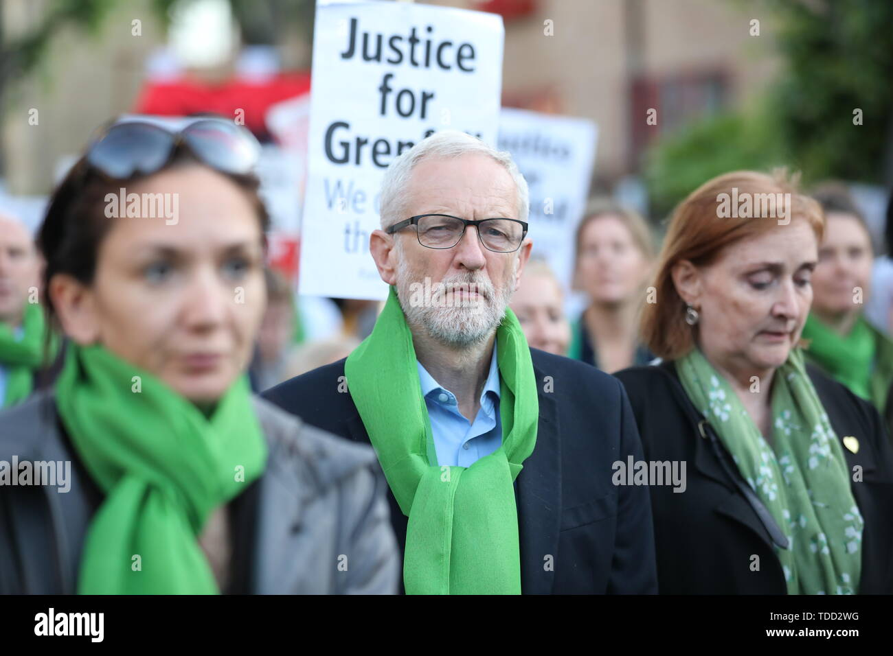 Labour leader Jeremy Corbyn walks with family and friends of the 72 people who lost their lives in the Grenfell Tower block fire, outside Grenfell Tower, London, during a silent walk to mark the two-year anniversary. - Stock Image
