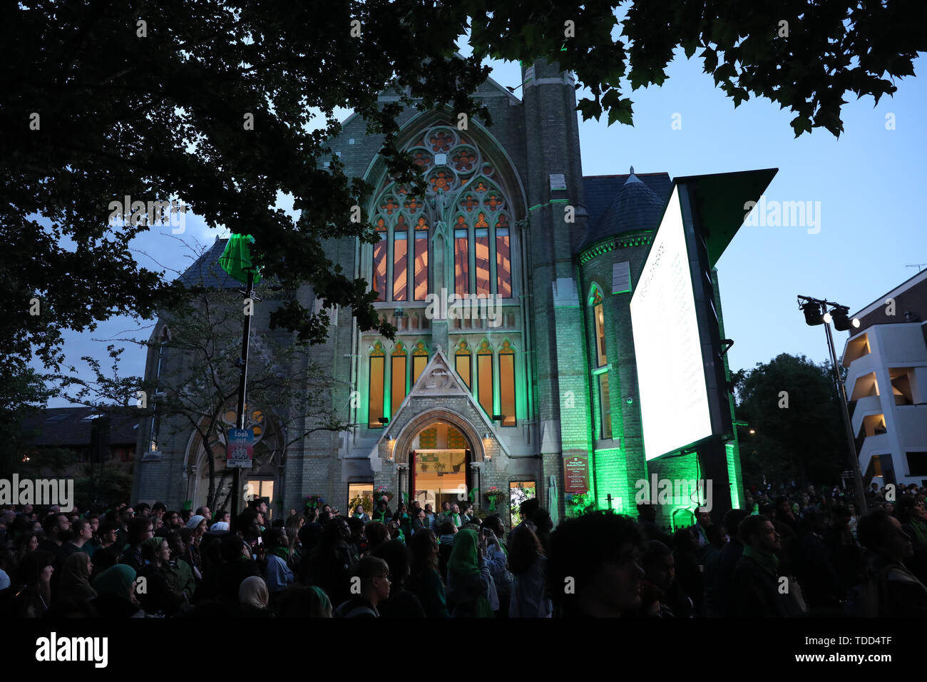 People take part in a vigil outside Notting Hill Methodist Church near Grenfell Tower, London, to mark the two-year anniversary of the tower block fire. - Stock Image