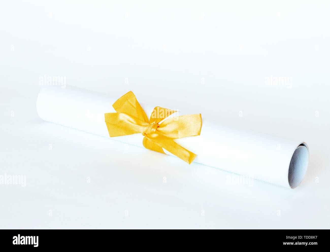 Certificate diploma with golden ribbon isolated on white background. - Stock Image