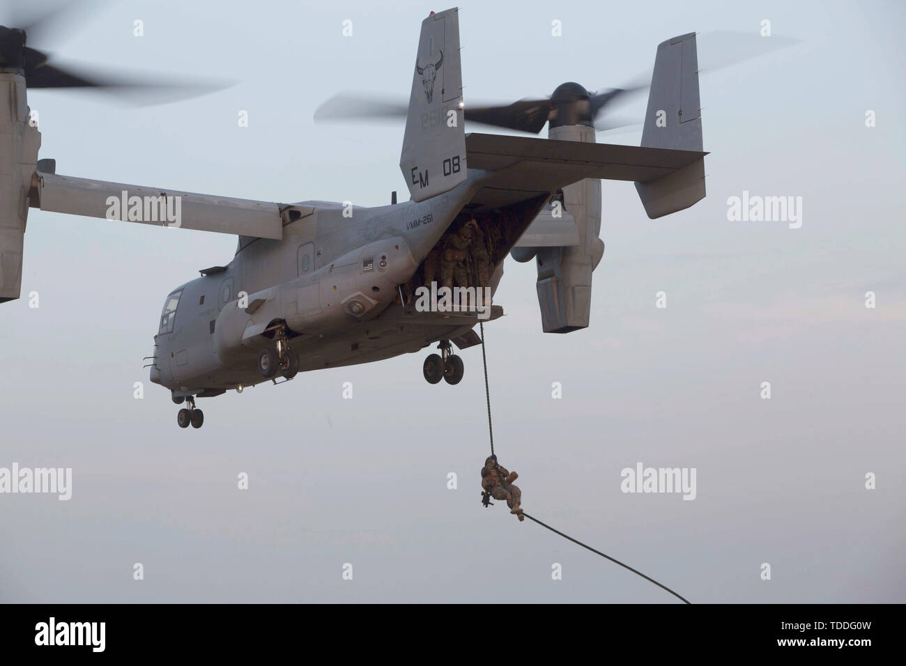 A U.S. Marine with the Special Purpose Marine Air-Ground Task Force-Crisis Response-Africa 19.2, Marine Forces Europe and Africa, descends a rope out of a U.S. Marine Corps MV-22B Osprey during fast- rope training at Naval Air Station Sigonella, Italy, June 10, 2019. SPMAGTF-CR-AF is deployed to conduct crisis-response and theater-security operations in Africa and promote regional stability by conducting military-to-military training exercises throughout Europe and Africa. (U.S. Marine Corps photo by Staff Sgt. Mark E Morrow Jr.) Stock Photo