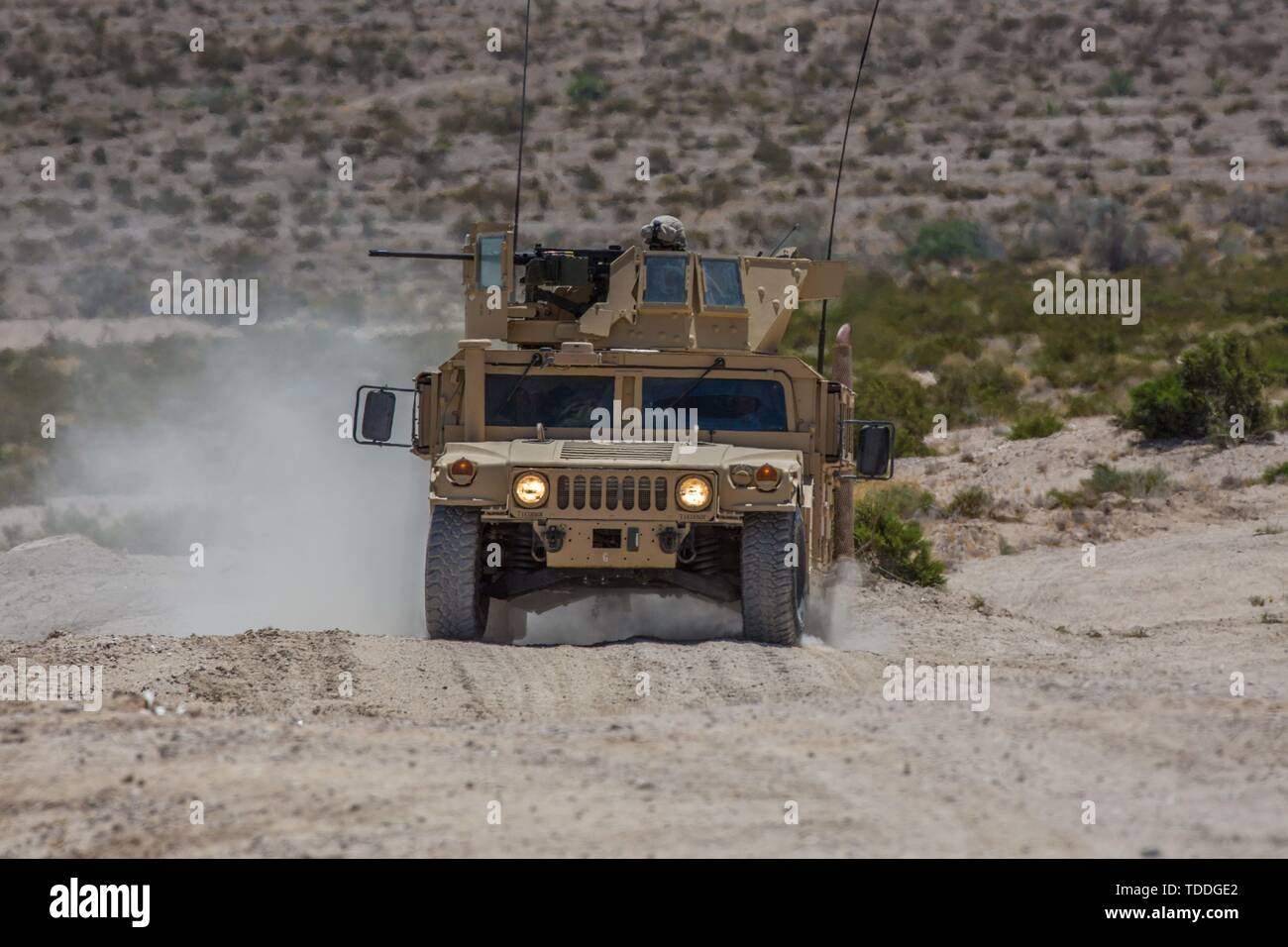 A Humvee with Engineer Company, Combat Logistics Battalion 23, 4th Marine Logistics Group, provides security for the main attack body of the mechanized assault course during Integrated Training Exercise 4-19 at Marine Corps Air Ground Combat Center, Twentynine Palms, Calif., June 12, 2019. Marine Forces Reserve units participate in ITX to both complete annual training requirements and to increase unit readiness and proficiency. (U.S. Marine Corps photo by Lance Cpl. Preston L. Morris) Stock Photo