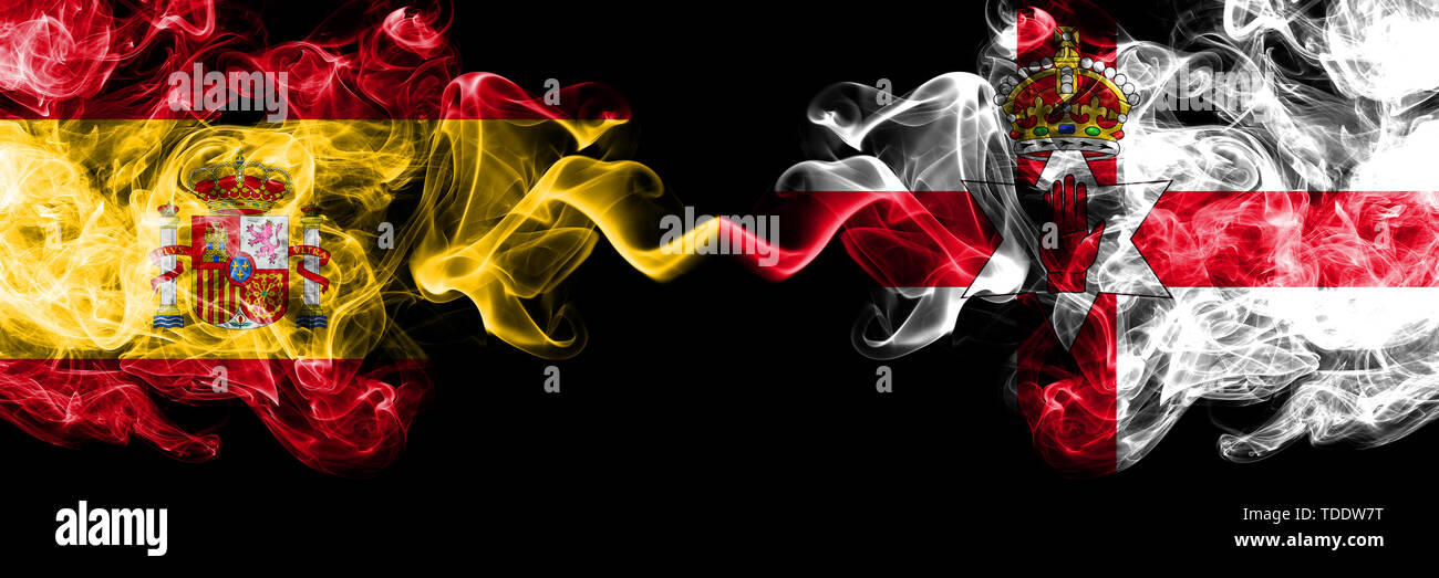Spain vs Northern Ireland smoky mystic flags placed side by side. Thick colored silky smokes flag of Spanish and Northern Ireland - Stock Image