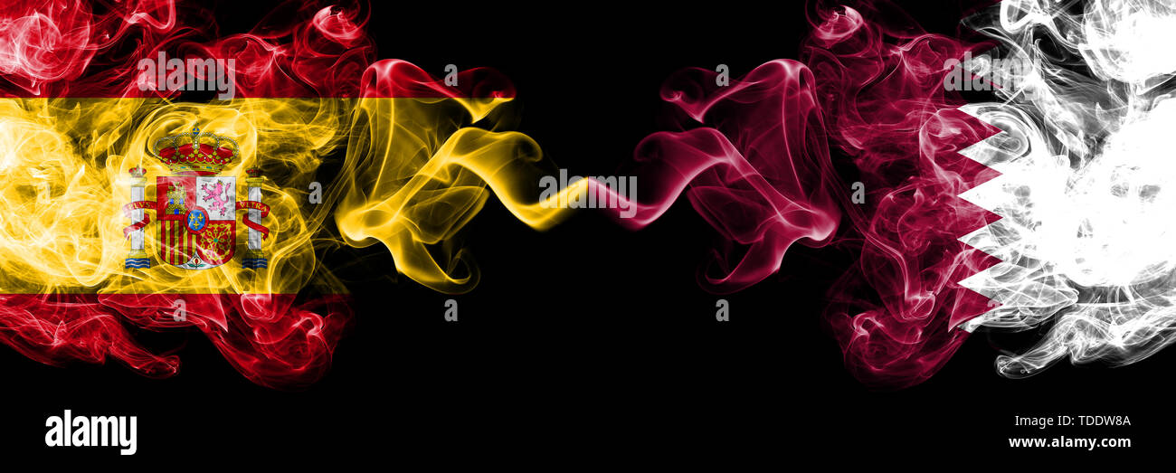 Spain vs Qatar, Qatari smoky mystic flags placed side by side. Thick colored silky smokes flag of Spanish and Qatar, Qatari Stock Photo