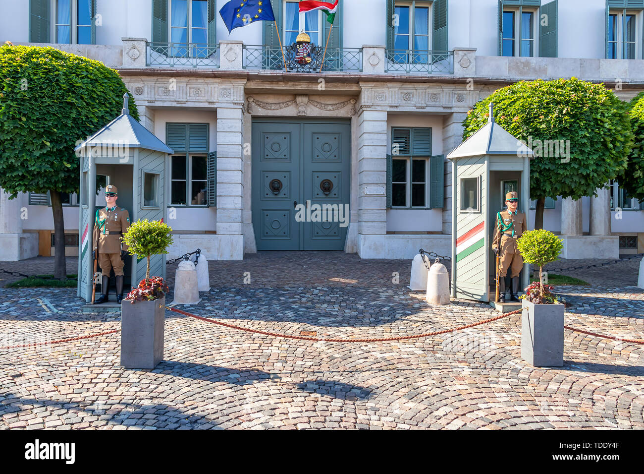 Guardsmen with a carbine guard protects the residence of the President of the State, Presidential Palace Sandor, Bu Stock Photo