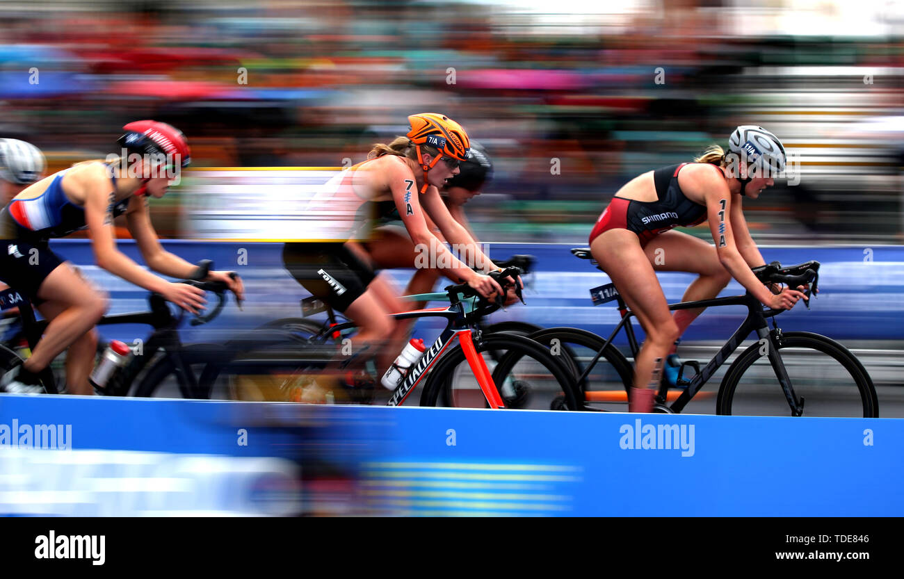 Athletes on their bikes during the Accenture World Triathlon Mixed Relay at Nottingham Embankment. - Stock Image