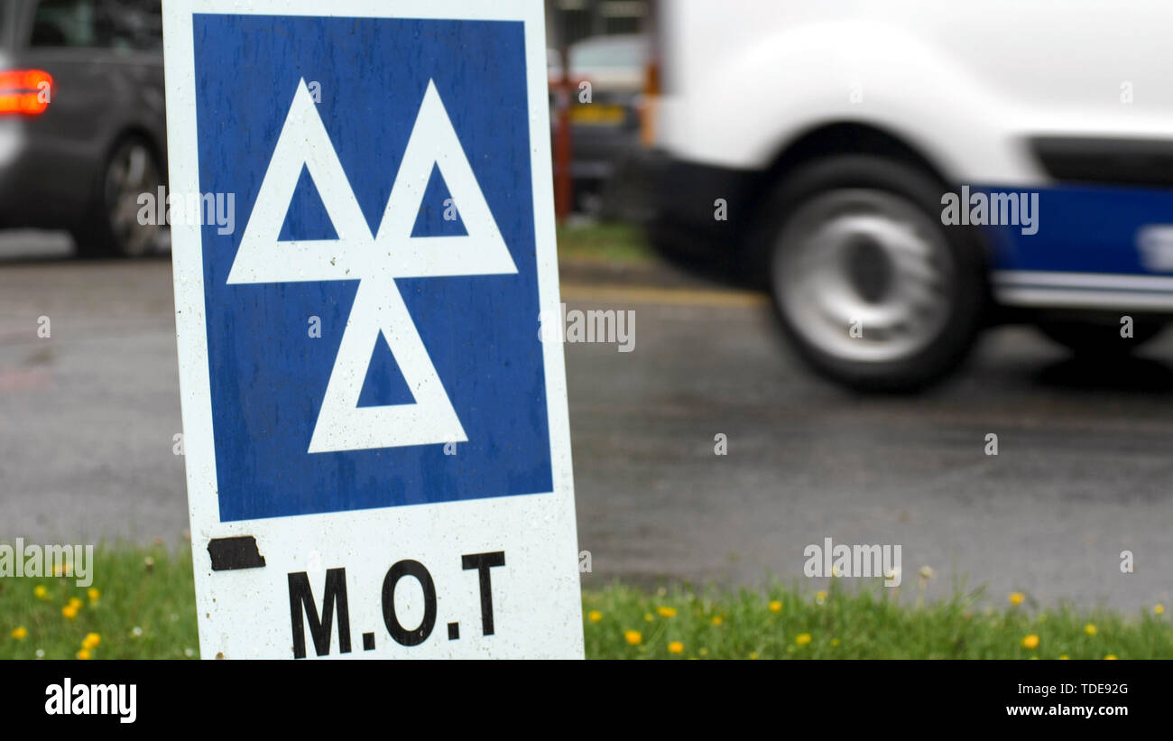 Blue MOT service sign on british road on cloudy rainy day - Stock Image