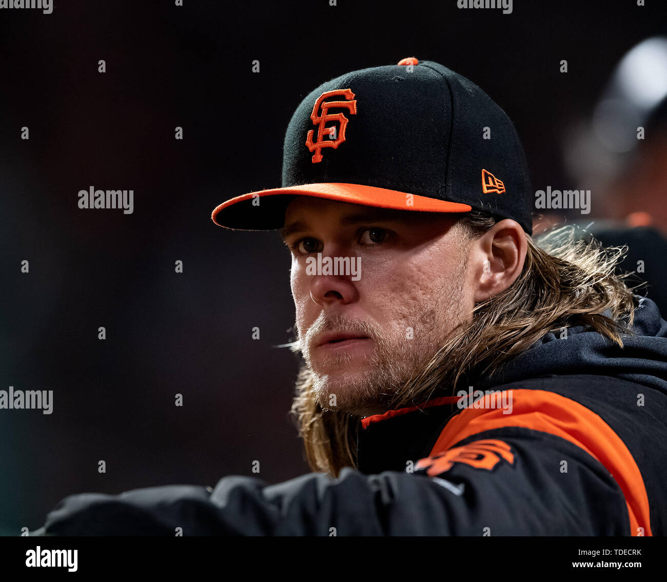 San Francisco, California, USA. 14th June, 2019. San Francisco Giants starting pitcher Shaun Anderson (64) watches the game from the dugout, during a MLB game between the Milwaukee Brewers and the San Francisco Giants at Oracle Park in San Francisco, California. Valerie Shoaps/CSM/Alamy Live News - Stock Image