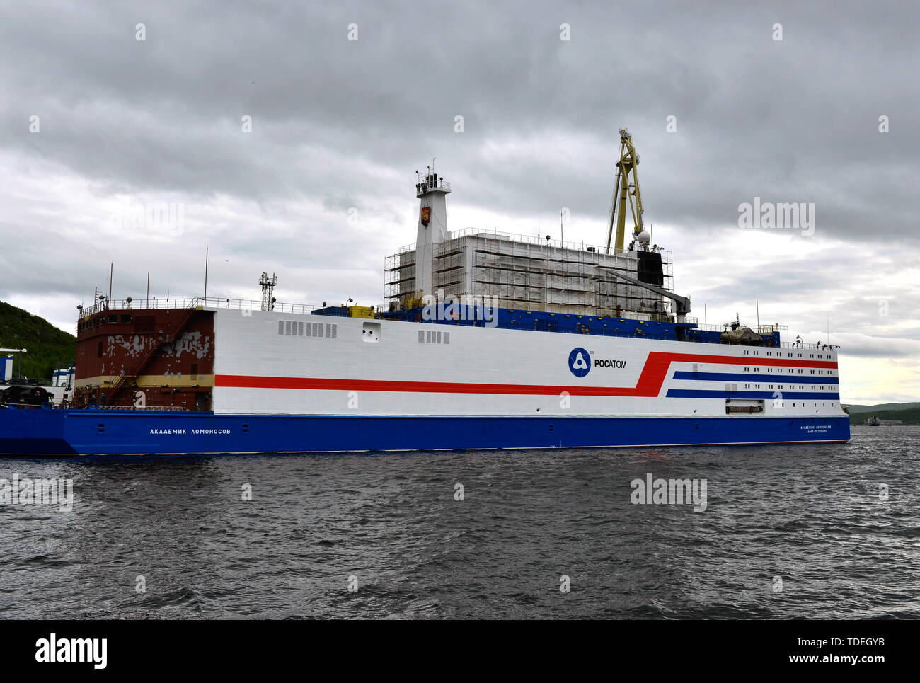 MURMANSK, RUSSIA - JUNE 14, 2019: A view of Akademik Lomonosov, a floating nuclear power unit, its hull painted at the Atomflot base; being part of a floating nuclear power station, the vessel belongs to a new class of energy sources based on Russian nuclear shipbuilding technologies. Lev Fedoseyev/TASS - Stock Image
