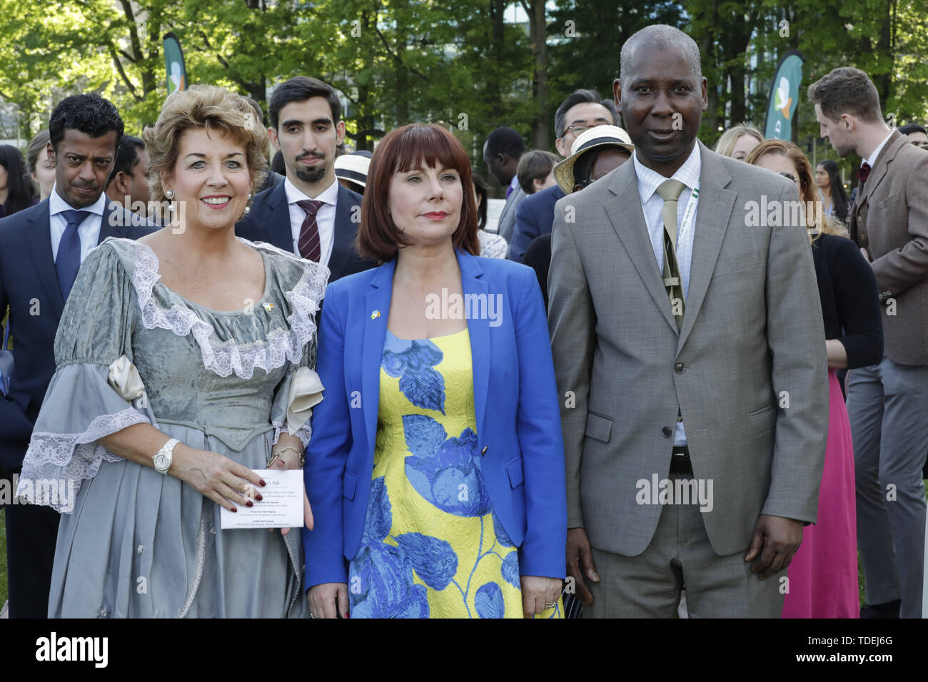 New York, NY, USA. 14th June, 2019. United Nations, New York, USA, June 15, 2019 - Irish Minister Culture, Heritage & the Gaeltacht Josepha Madigan, Permanent Representative of Ireland to the United Nations Geraldine Byrne Nason and Tijjani Muhammad-Bande, Permanent Representative of Nigeria to the United Nations and President elected of the General Assembly dress in the fashion of the early 1800s a tended the first celebration of Blooms day today at the UN Headquarters in New York. The Bloomsday Festival is an annual celebration of James Joyce's modernist epic Ulysses, the events of which t - Stock Image