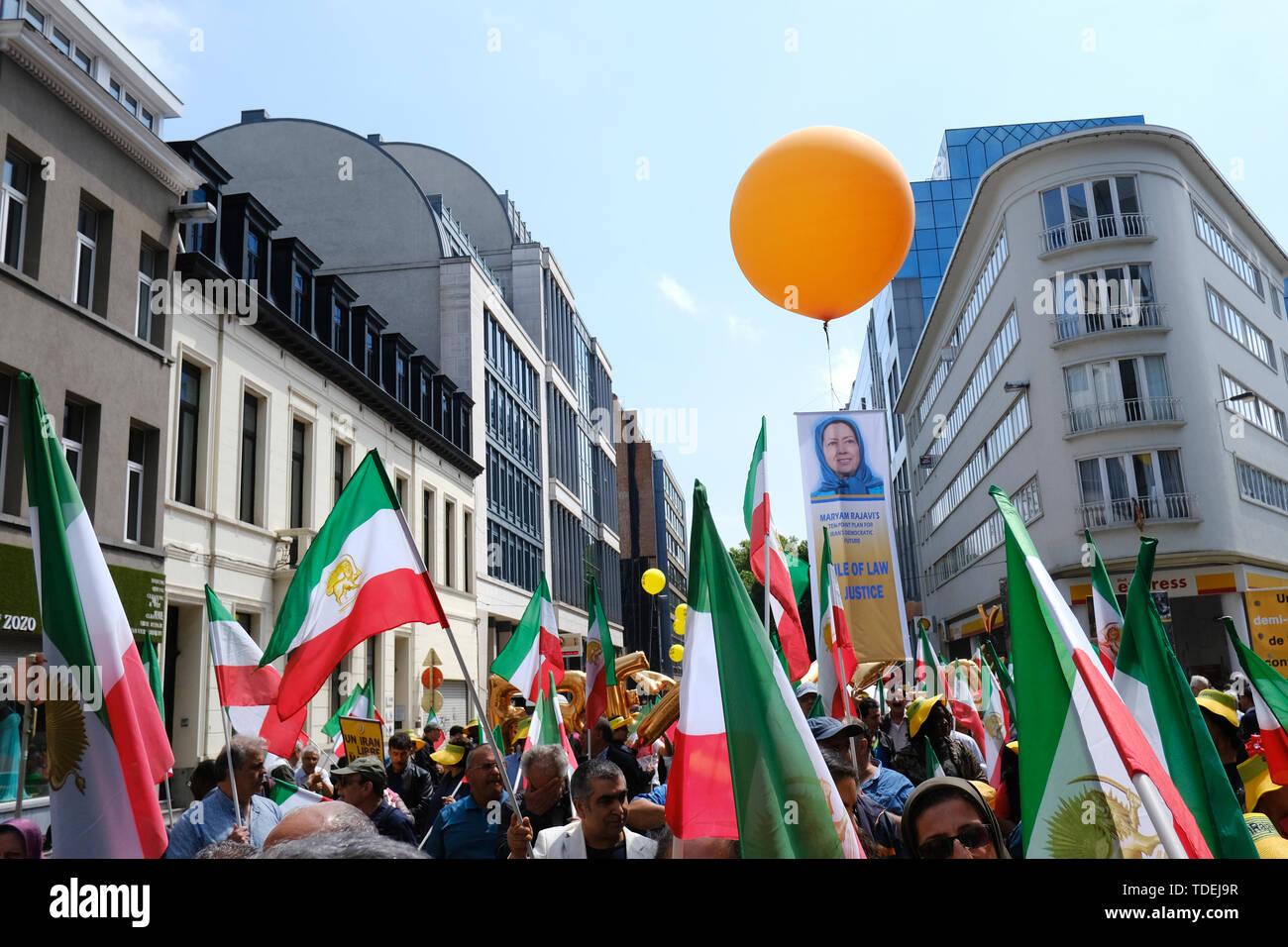 Brussels, Belgium. 15th June, 2019. Protesters hold Iranian flags as they attend a demonstration against the Iranian government and system. The demonstration organized by the National Council of Resistance of Iran (NCRI) is held to support Iranians in their fight for freedom and democracy in Iran. Credit: ALEXANDROS MICHAILIDIS/Alamy Live News - Stock Image