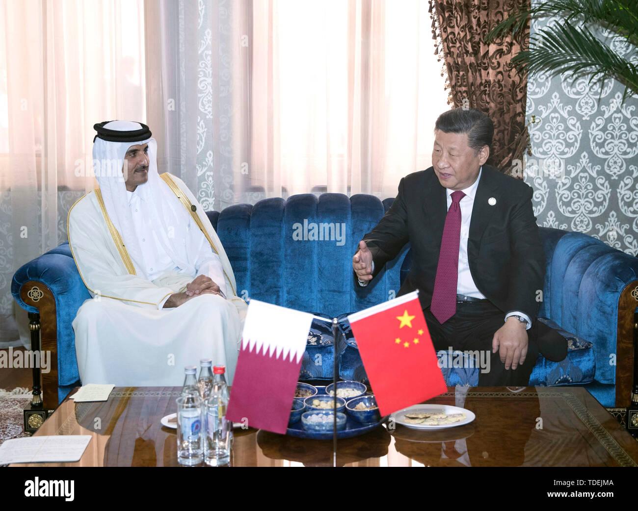 (190615) -- DUSHANBE, June 15, 2019 (Xinhua) -- Chinese President Xi Jinping (R) meets with Qatari Emir Sheikh Tamim Bin Hamad Al-Thani in Dushanbe, Tajikistan, June 15, 2019. (Xinhua/Wang Ye) - Stock Image