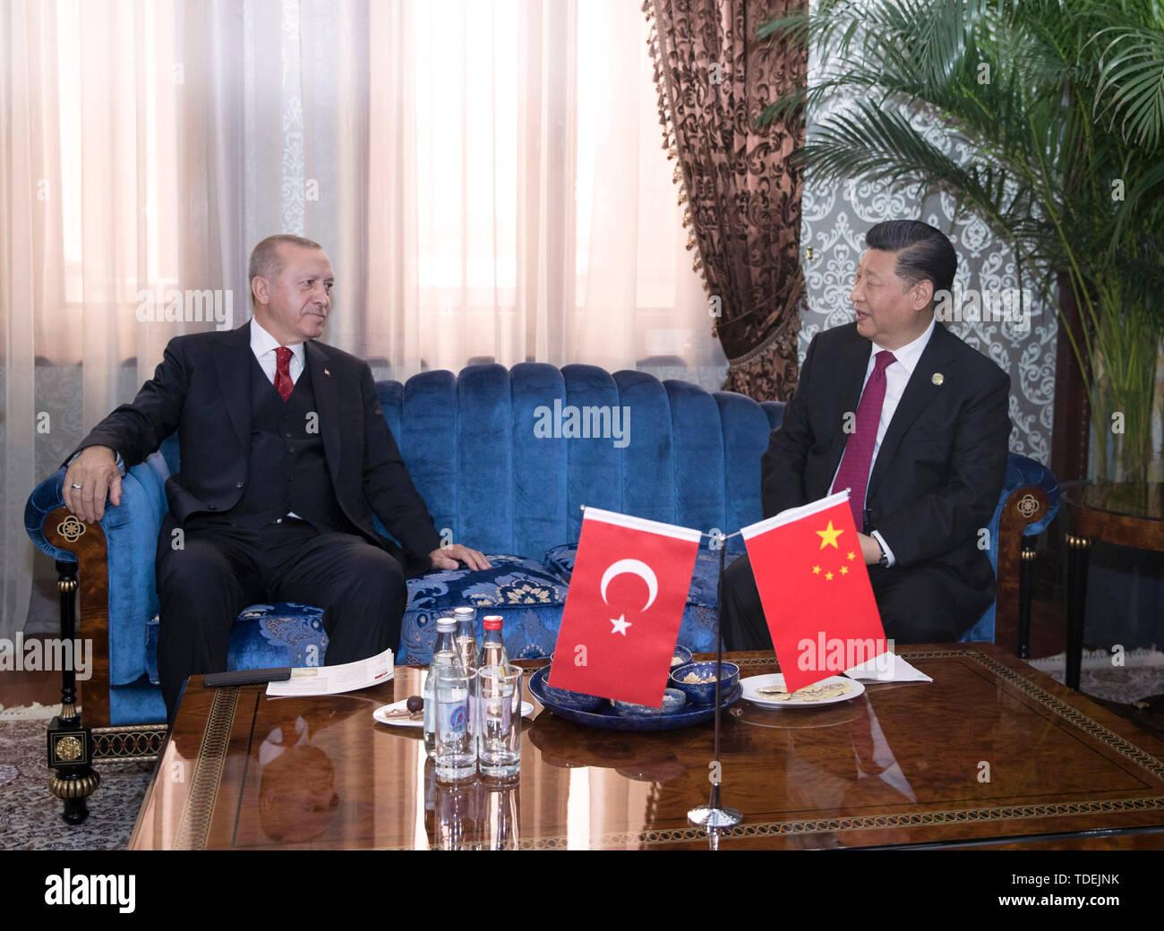 Dushanbe, Tajikistan. 15th June, 2019. Chinese President Xi Jinping (R) meets with his Turkish counterpart Recep Tayyip Erdogan in Dushanbe, Tajikistan, June 15, 2019. Credit: Wang Ye/Xinhua/Alamy Live News - Stock Image
