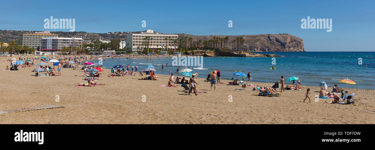 Xabia Spain Playa del Arenal beach in summer with tourists also known as Javea panoramic view - Stock Image