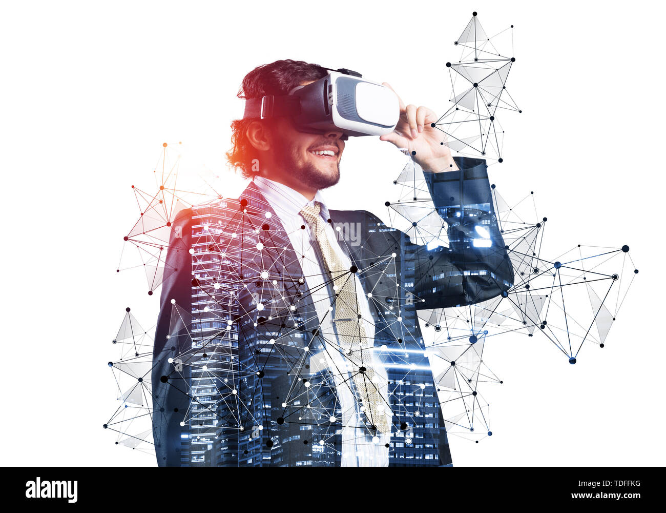 Businessman wearing VR goggles and exploring virtual reality. Man standing and touching VR headset. Studio photo businessperson in formal wear against - Stock Image