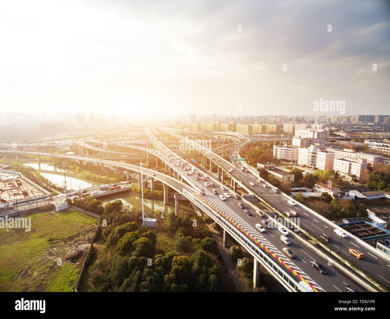 busy road junction in midtown of shanghai in cloud sky - Stock Image