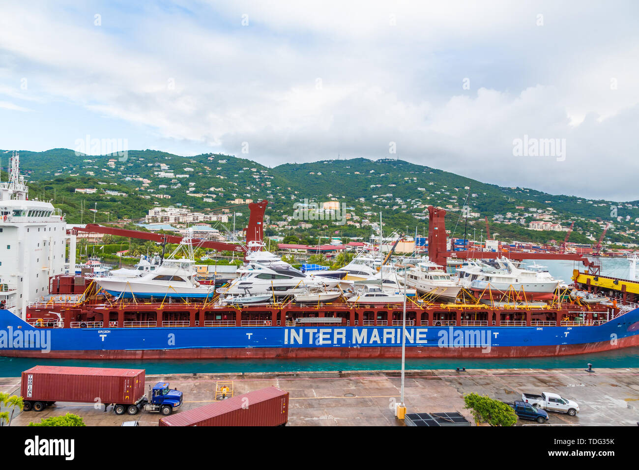 ST THOMAS, USVI - December 5, 2016: Freighters now carry most of the world's cargo and the largest container ships can carry over 21,000 units of frei - Stock Image