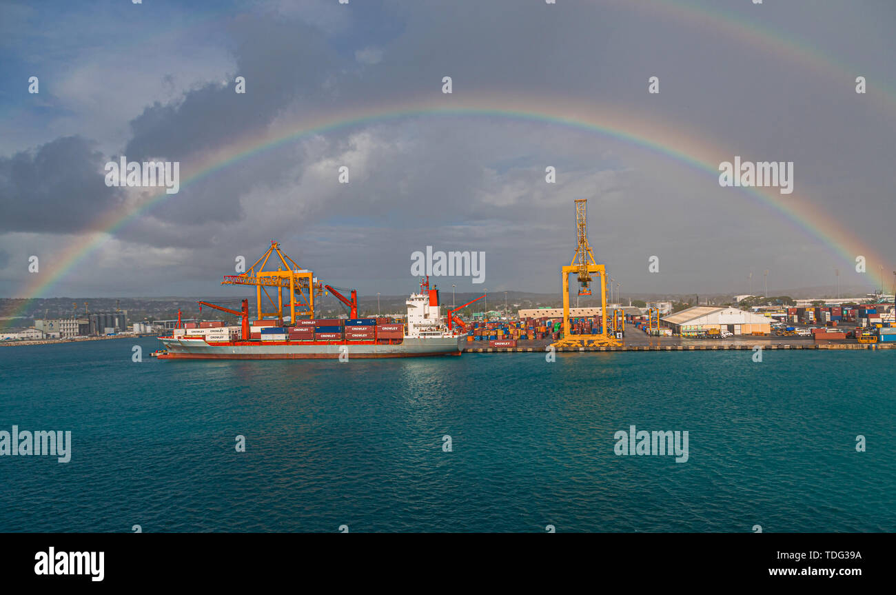 BRIDGETOWN, BARBADOS - December 15, 2016: Freighters now carry most of the world's cargo and the largest container ships can carry over 21,000 units o - Stock Image