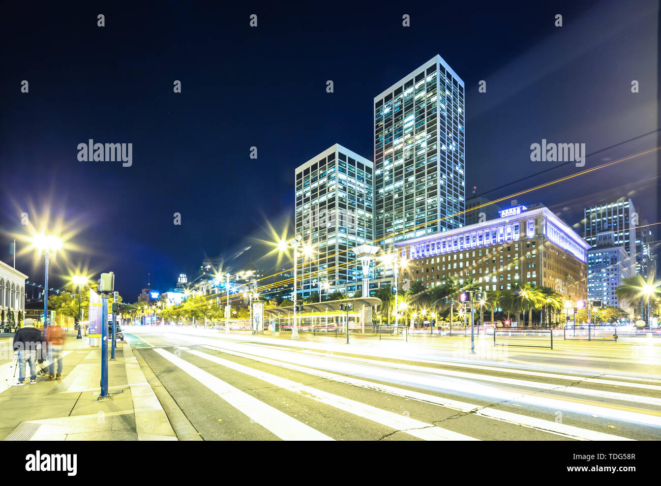 modern office buildings at night in downtown of san francisco on view from busy road - Stock Image