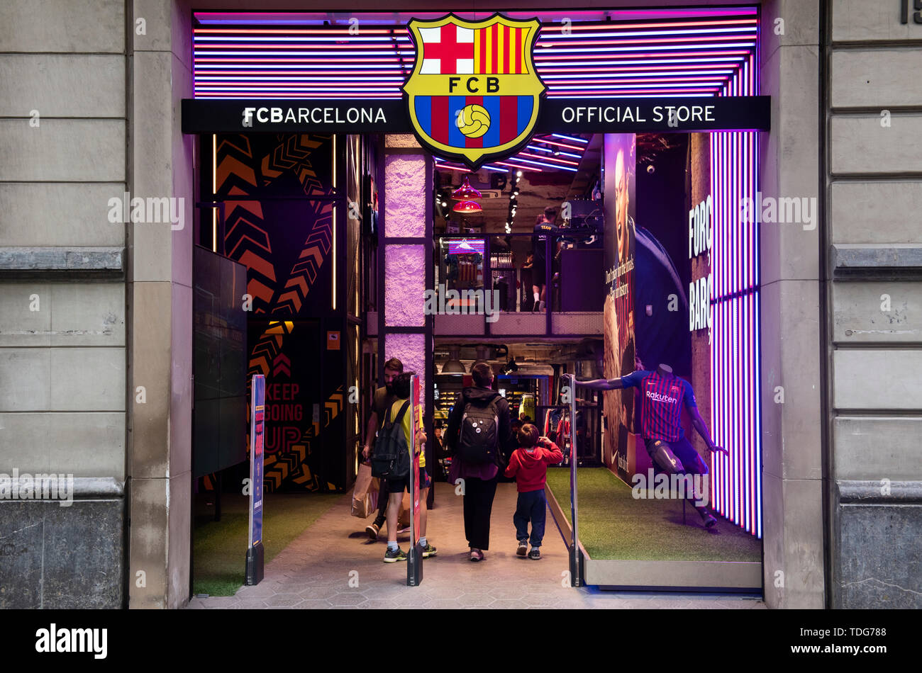 Customers enter at the Spanish professional football team the Futbol Club Barcelona store in Barcelona. - Stock Image
