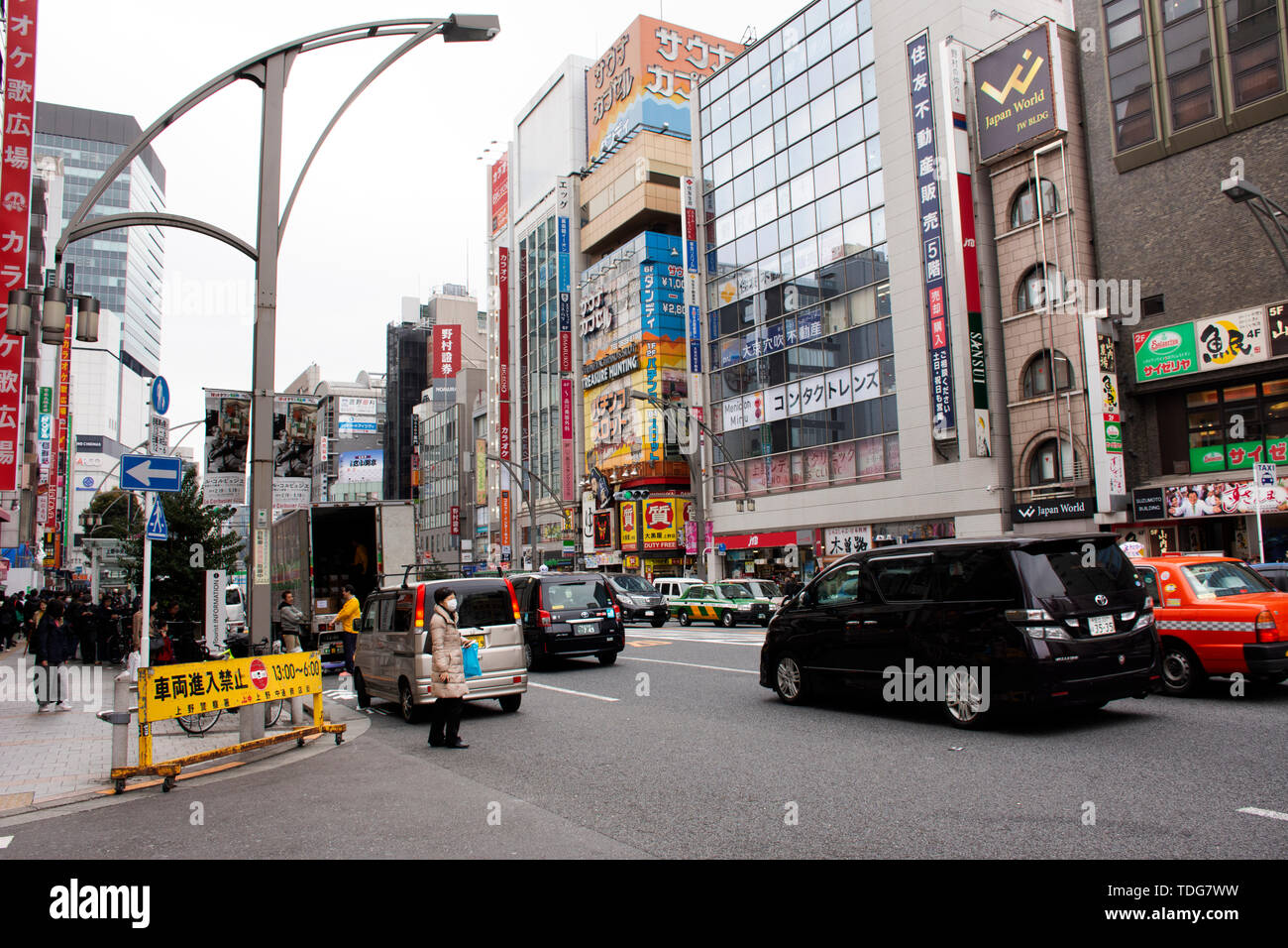 Japanese people and foreigner traveler walk visit and shopping beside road with traffic road of chuo dori street at Ueno city on March 30, 2019 in Tok - Stock Image