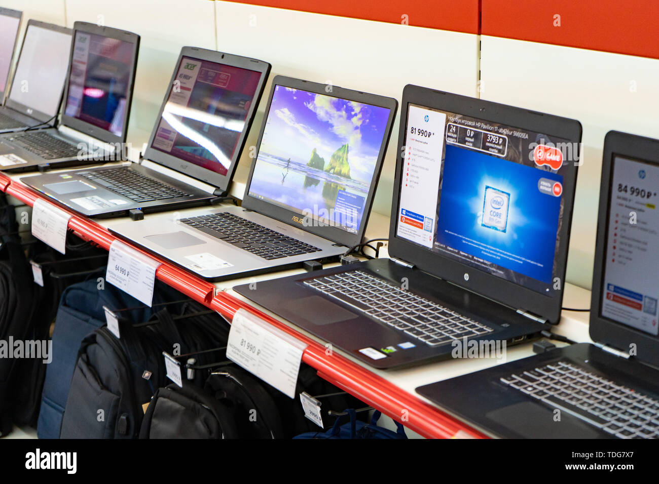 Chelyabinsk Region, Russia - June 2019. Household electrical appliances store M Video. Shelving with goods. Computers and laptops. Stock Photo