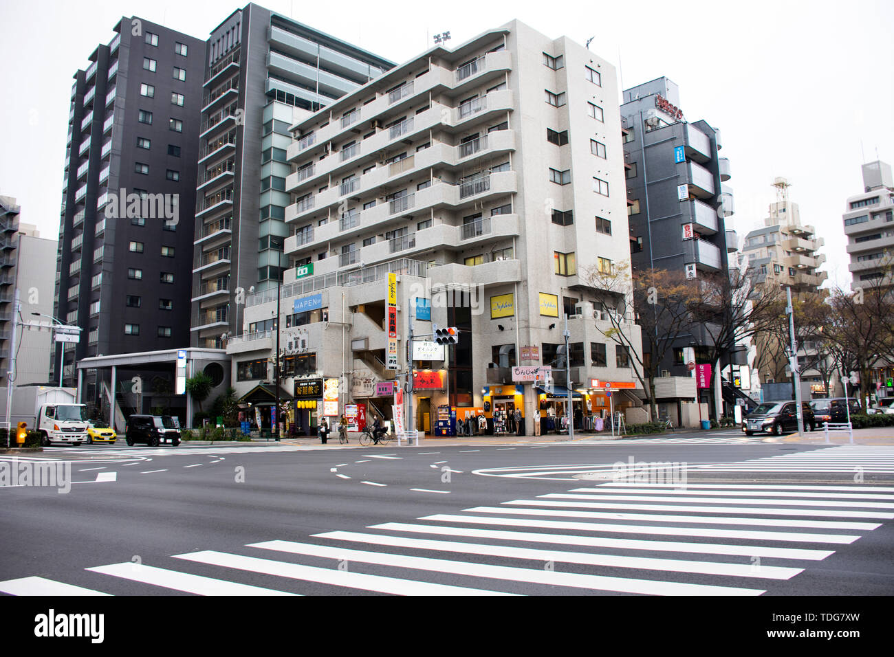 View landscape and cityscape with japanese people walking crossing traffic road evening of Kannana dori street at Higashikasai, Edogawa city on March  Stock Photo
