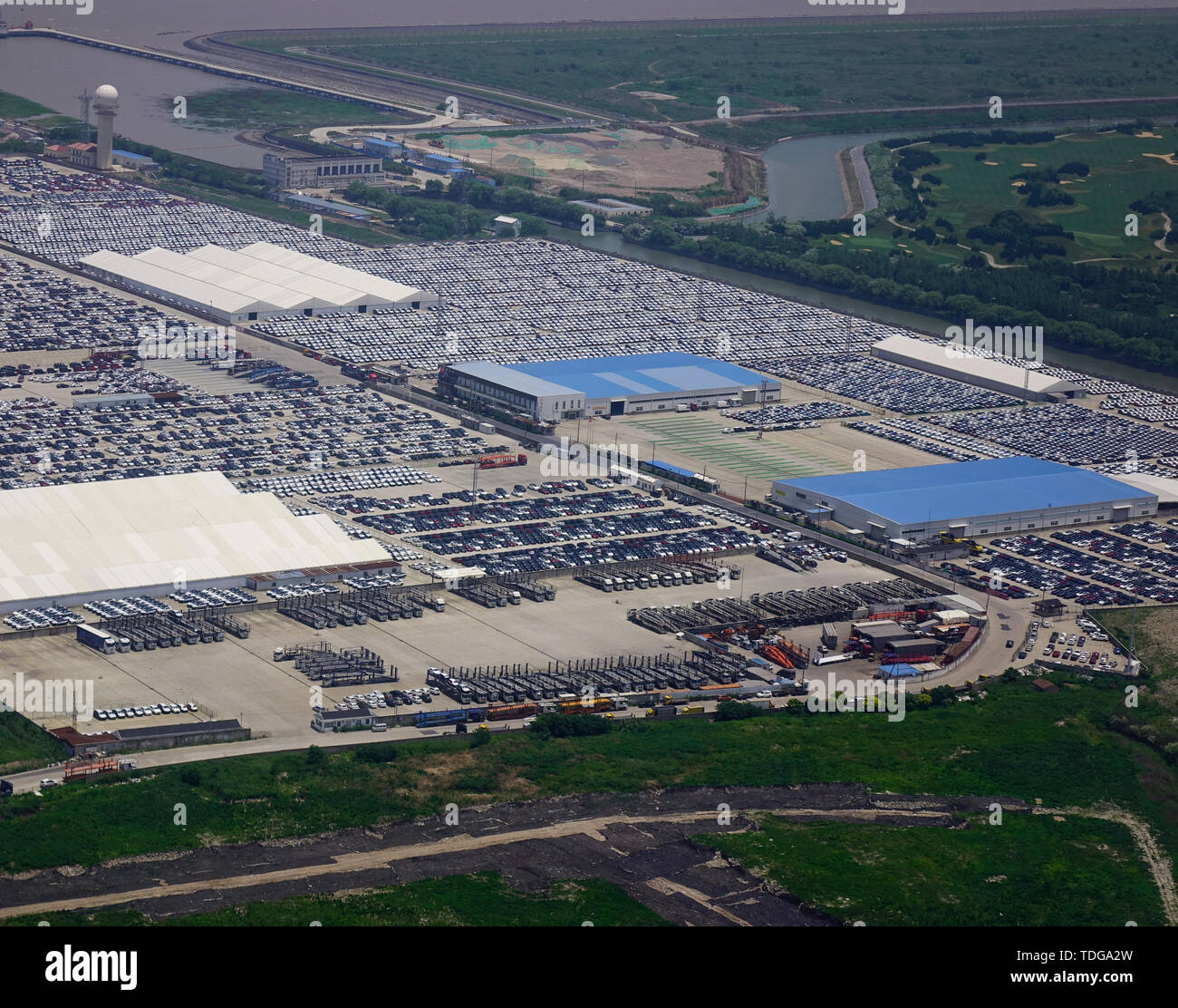 New cars from the car factory parked at the port waiting for export to the country as ordered. - Stock Image