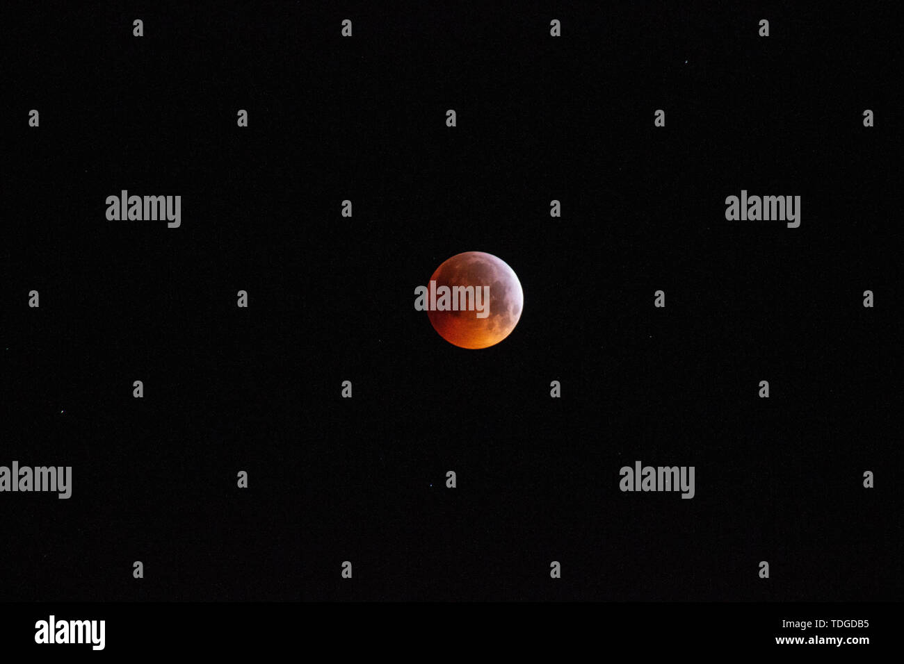 Total lunar eclipse 2018 , red moon with black background - Stock Image