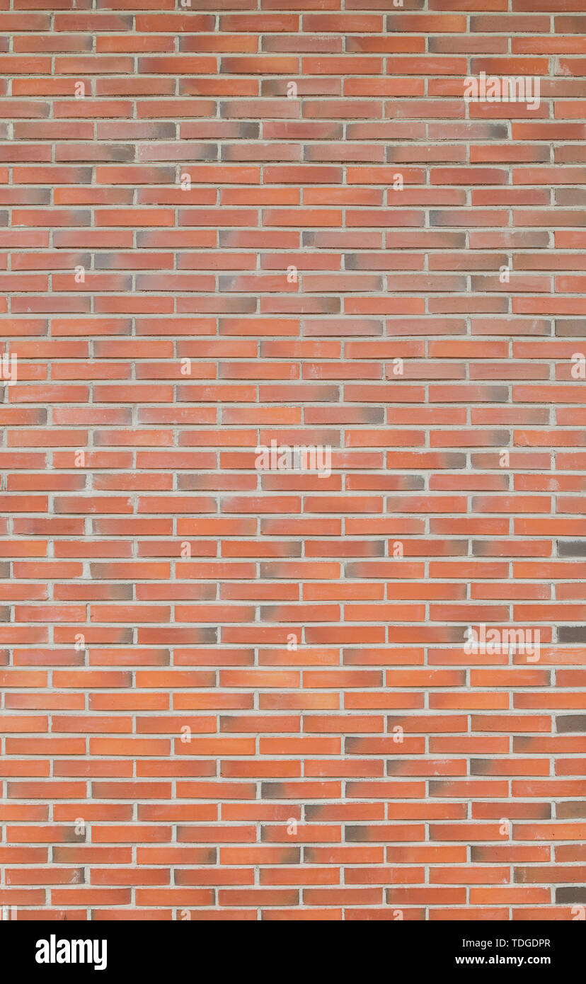 High resolution full frame background of detailed new red brick wall. Stock Photo