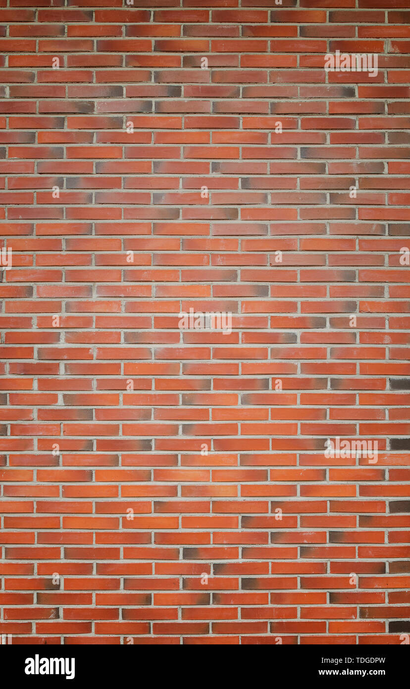High resolution full frame background of detailed new red brick wall with vignetting. Stock Photo