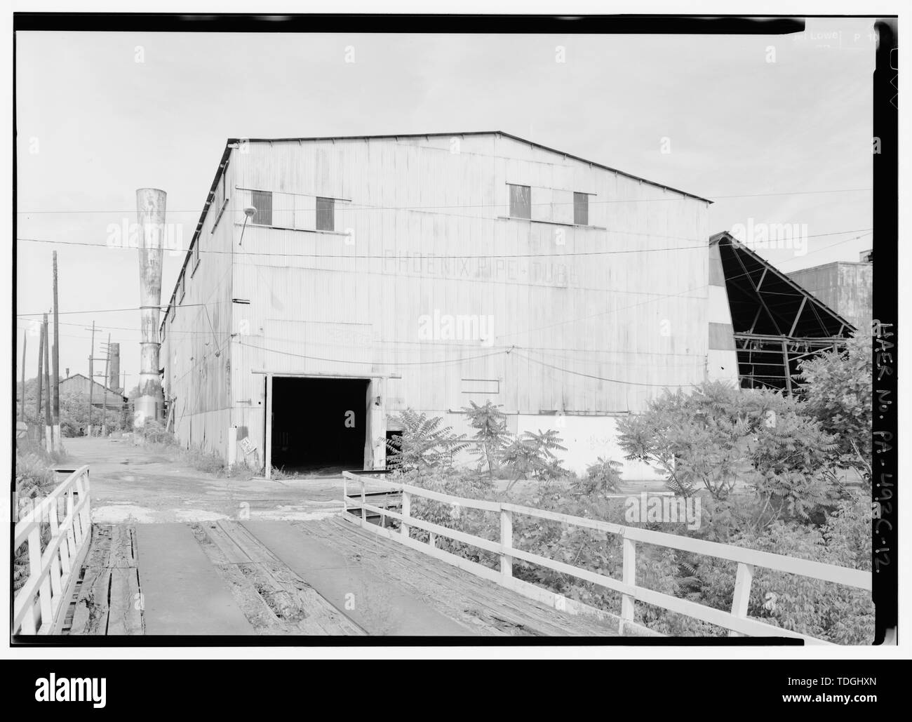 NW corner of rolling mill, looking east from bridge over French Creek. - Phoenix Iron Company, Rolling Mill, North of French Creek, west of Fairview Avenue, Phoenixville, Chester County, PA; DeLony, Eric N, project manager; Pennsylvania Department of Transportation, sponsor; Pennsylvania Historical and Museum Commission, sponsor; Lowe, Jet, photographer - Stock Image