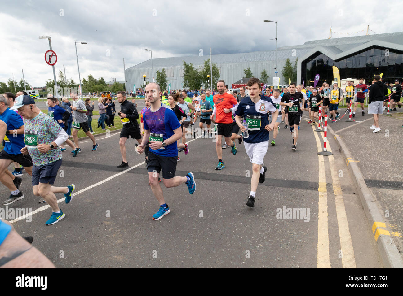 Glasgow, UK. 16th June 2019. The Men's 10K sets off from the riverside museum on Glasgow's Clydeside. Thousands of runners take part in this year's event which has been running since 2004.  It is hoped that the event will promote health and wellbeing amongst men in the west of Scotland. Credit: Garry Cornes/Alamy Live News - Stock Image