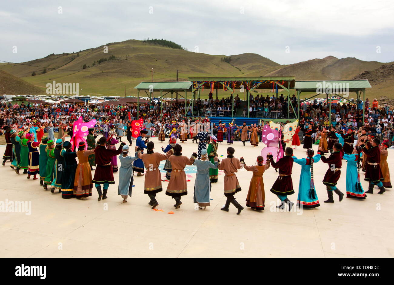 Irkutsk, Russia. 15th June, 2019. IRKUTSK REGION, RUSSIA - JUNE 15, 2019: Participants perform a round dance at the 7th Yordynian Games - Eurasian Peoples' Games, an ethnic and cultural festival of the local indigenous peoples, held at the foot of the sacred Mount Yord near Lake Baikal. Kirill Shipitsin/TASS Credit: ITAR-TASS News Agency/Alamy Live News Stock Photo