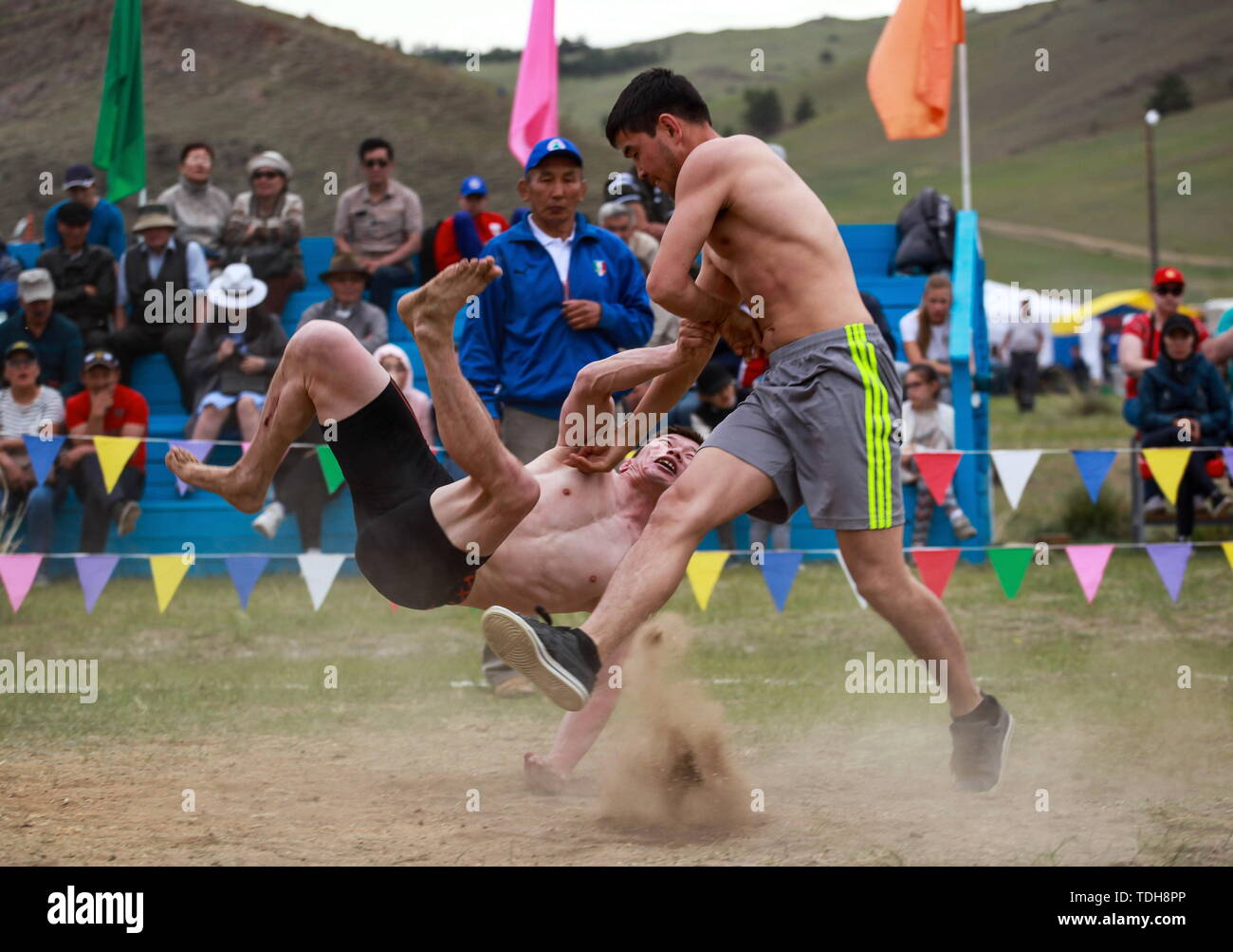 Irkutsk, Russia. 15th June, 2019. IRKUTSK REGION, RUSSIA - JUNE 15, 2019: Buryat wrestlers perform at the 7th Yordynian Games - Eurasian Peoples' Games, an ethnic and cultural festival of the local indigenous peoples, held at the foot of the sacred Mount Yord near Lake Baikal. Kirill Shipitsin/TASS Credit: ITAR-TASS News Agency/Alamy Live News Stock Photo