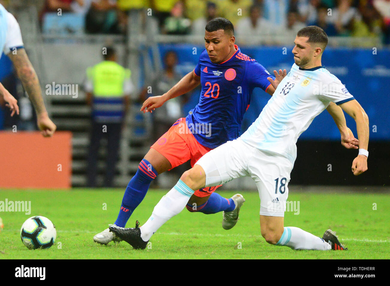15th June 2019, Arena Fonte Nova, Salvador, Bahia, Brazil; Copa America International Football tournament, Argentina versus Colombia;  Guido Rodríguez of Argentina challenges Roger Martínez of Colômbia Stock Photo