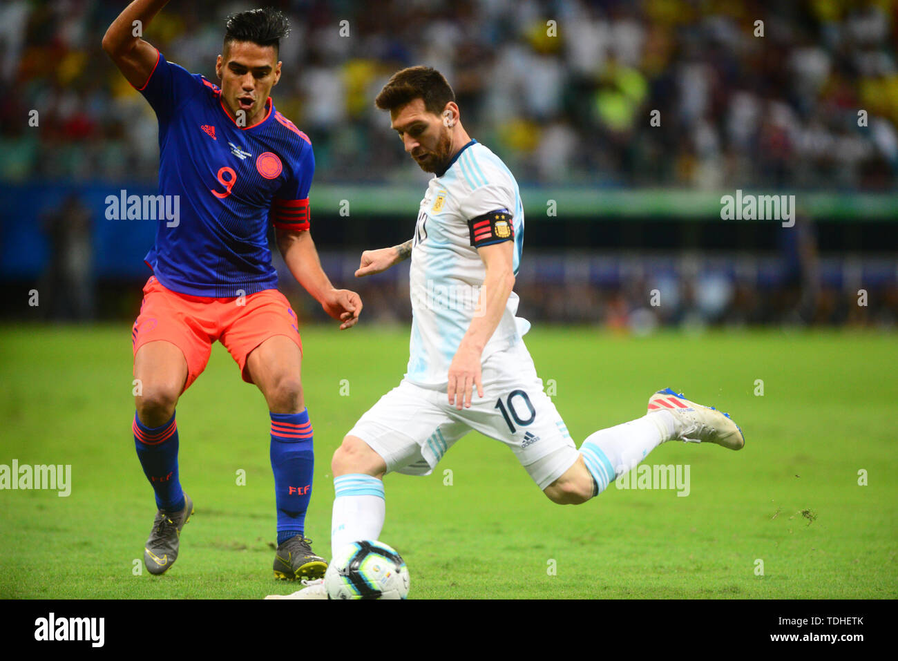 15th June 2019, Arena Fonte Nova, Salvador, Bahia, Brazil; Copa America International Football tournament, Argentina versus Colombia;  Lionel Messi of Argentina shoots as Radamel Falcao of Colombia closes him down - Stock Image
